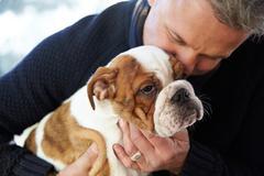 Mature Man Holding English Bulldog Puppy Kuvituskuvat