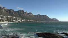 Panning shot of Camps Bay Beach with 12 Apostles mountains in the background, Stock Footage