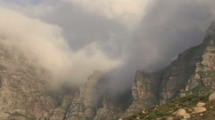 Zoom out of clouds rolling over 12 Apostle mountains, Cape Town,South Africa - stock footage