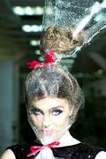 Woman head in cellophane Stock Photos