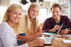 Daughter helping her parents with new technology - stock photo