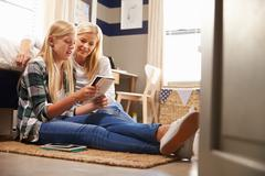 Mother and daughter reading together Stock Photos