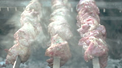 Pieces of roasted shashlik beef meat on grill. Street food. Stock Footage