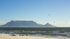 Time-lapse of windsurfers with Table Mountain,Cape Town,South Stock Footage