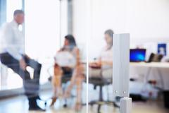 Colleagues talking in a modern office Kuvituskuvat