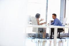 Two people talking in an office - stock photo