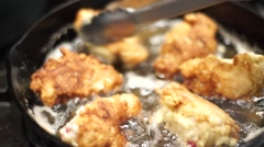 Stock Video Footage of Frying Chicken Tight Shot