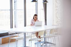 Young woman in empty meeting room Stock Photos