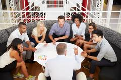 Group of work colleagues having meeting in an office lobby Stock Photos