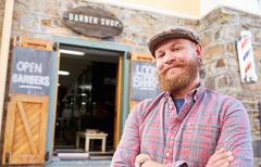 Portrait Of Hipster Barber Standing Outside Shop Stock Photos