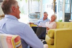 Senior Couple At Home Meeting With Financial Advisor Stock Photos