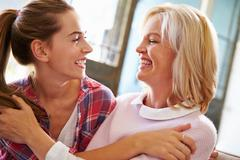 Affectionate Mature Mother With Adult Daughter At Home - stock photo