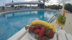 Fruit and drinks on table by the pool. Party at resort, hotel Stock Footage