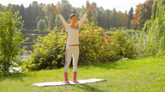 Young woman doing fitness exercises for arms, elbows and shoulders in the park. Stock Footage