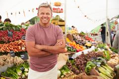 Male Stall Holder At Farmers Fresh Food Market - stock photo