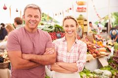 Couple Running Stall At Farmers Fresh Food Market - stock photo