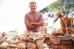 Male Bakery Stall Holder At Farmers Fresh Food Market - stock photo