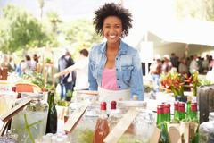 Woman Selling Soft Drinks At Farmers Market Stall Stock Photos