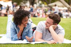 Couple Relaxing At Outdoor Summer Event - stock photo