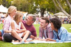 Older Family Relaxing At Outdoor Summer Event Stock Photos