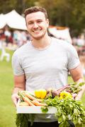 Man With Fresh Produce Bought At Outdoor Farmers Market - stock photo