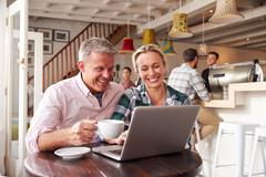 Couple meeting in a cafe - stock photo