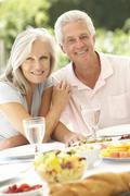 Senior couple enjoying al fresco meal Stock Photos