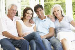 Portrait Of Mature Parents Relaxing With Grown Up Children Stock Photos