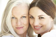 Portrait Of Mature Mother  Relaxing With Grown Up Daughter Stock Photos