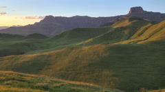 Time lapse of sunrise lighting up Drakensberg mountains, South Africa Stock Footage