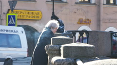 Old Lady Smoking at River Embankment in St. Petersburg, Russia Stock Footage
