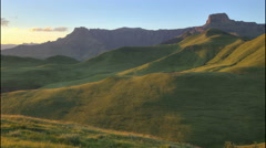 4k Time lapse of sunrise lighting up Drakensberg mountains,South Africa Stock Footage