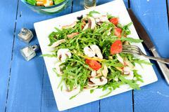 seasonal salad on the blue table - stock photo