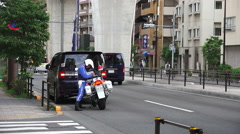 Pulled Over On The Streets Of Tokyo Japanese Motorcycle Officer Writes Ticket Stock Footage