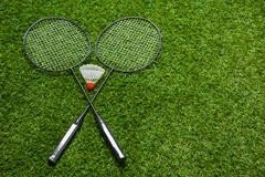 Crossed badminton rackets with shuttlecock - stock photo