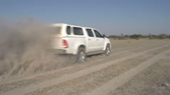 Car driving on dustry track in the African bush, Botswana - stock footage