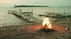 Bonfire Flames in Fire Pit at Beach Sunset in Canada - stock footage