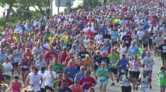 Runners in raod race, mass of runners Stock Footage