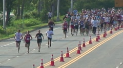 Runners in race after start Stock Footage