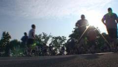 RUNNERS THROUGH SUNFLARE Stock Footage