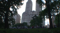 Runners in Central Park, San Remo in background Stock Footage