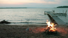 Bonfire Flames in Fire Pit at Beach Sunset Arkistovideo