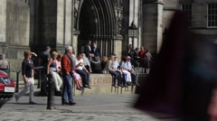 Tourists outside St Giles' Cathedral, Royal Mile,  Edinburgh, Scotland - stock footage