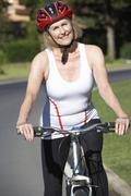 Senior Woman On Cycle Ride - stock photo