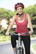 Woman On Cycle Ride - stock photo