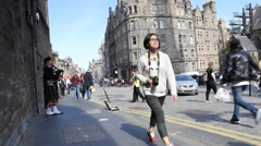 Tourists walking in Royal Mile in Edinburgh, Scotland - stock footage