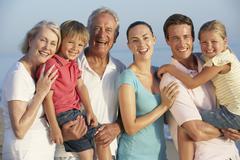 Portrait Of Three Generation Family On Beach Holiday Stock Photos