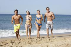 Group Of Friends Enjoying Beach Holiday Stock Photos