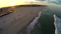 Flying over a beach at sunset Stock Footage