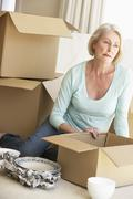 Senior Woman Moving Home And Packing Boxes Stock Photos